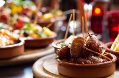 Bacon-wrapped dates at a Tapas Bar. stock photo