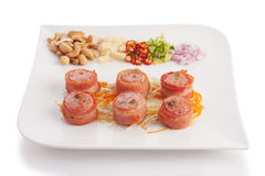 Bacon wrapped with fermented Thai pork Stock Image