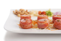 Bacon wrapped with fermented Thai pork Royalty Free Stock Photo