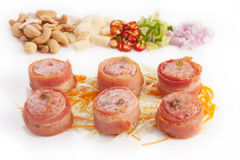Bacon wrapped with fermented Thai pork Stock Photo