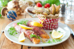 Bacon wrapped fish Stock Photography