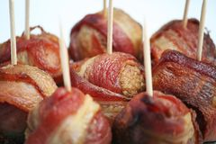 Bacon Wrapped Meatballs. With Toothpicks on White Stock Image