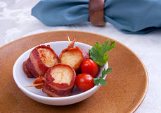 Bacon wrapped scallops Stock Photos