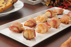 Bacon wrapped scallops stock image