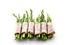 Bacon wrapping asparagus on isolate Royalty Free Stock Image