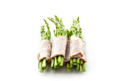 Bacon wrapping asparagus on isolate Stock Images