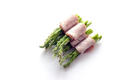 Bacon wrapping asparagus on isolate Royalty Free Stock Photography