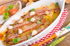 Baconpotatiseldfast form Arkivbild