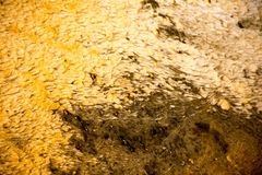 Bacteria Flowing. The bacterial mats at Yellowstone National Park were amazing and full of colors and textures. This bacterial mat had shades of yellow and brown Stock Photos