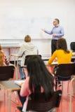 Baczni ucznie z nauczycielem w sala lekcyjnej Obraz Royalty Free