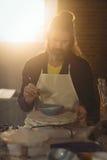 Baczny męski garncarka obraz na pucharze Fotografia Stock