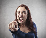 Bad Accuser. Ugly woman accusing someone with his index finger Stock Images
