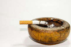 Bad addiction. Ashtray and cigarettes close-up. Royalty Free Stock Photos