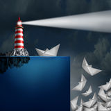 Bad Advice. Concept as a lighthouse with a light beacon falsely guiding paper ships off a cliff as a metaphor for incompetent or fraudulent financial Stock Photo