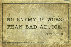 Bad advice Soph. No enemy is worse than bad advice - ancient Greek philosopher Sophocles quote printed on grunge vintage cardboard Royalty Free Stock Images