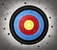 Bad aiming. Colred target with bullet holes around it in the wall Stock Images