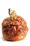 Bad apple. Rotten red apple with dried stem Stock Photo