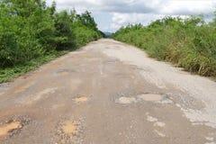 Bad asphalt countryside road Stock Photography