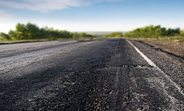 Bad asphalt road Royalty Free Stock Photo