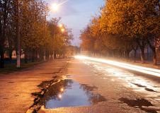 Bad asphalt in a small town stock photography