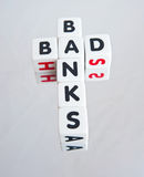 Bad banks. Text ' bad banks ' in black uppercase letters inscribed on small white cubes referring to need for recent bail-outs,  on bright background Stock Photos