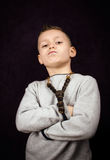 Bad boy. Studio shoot of a little boy with a bad attitude Royalty Free Stock Image