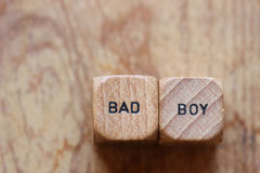 Bad Boy. Two wood dice with the words Bad boy printed on them with open space for copy royalty free stock photo