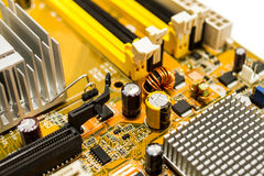 Bad capacitor on motherboard Royalty Free Stock Photo