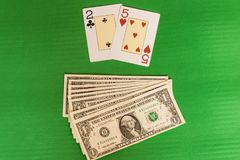 Bad card`s combination in poker win money. Bad bet card casino chance combination gamble gambling game green background luck money play poker risk table win Royalty Free Stock Image
