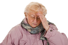 Bad Cold. Female senior with coat- got a bad cold-isolated on white background Stock Photos
