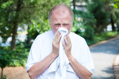 Bad cold or wiping sweat stock photography