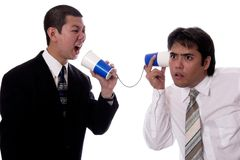 Bad Communication. Young businessman trying to communicate with co-worker Royalty Free Stock Image