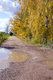 Bad condition autumn rural road after rain Stock Images