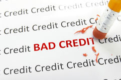 Bad credit. Macro pencil erasing bad credit Royalty Free Stock Photography