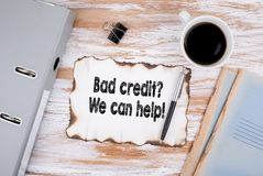 Bad credit, We can help. Business concept. Wooden desk with stationery and a cup of coffee Stock Image