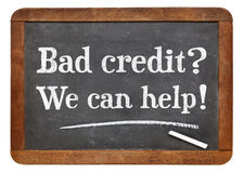 Bad credit? We can help!. White chalk text on a vintage slate blackboard Stock Photo