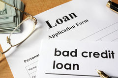 Bad credit loan. Page of Bad credit loan and application form on a table stock photo