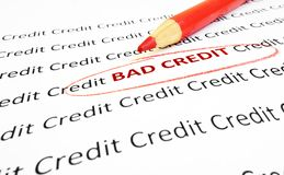 Bad credit. Text circled in red pencil Royalty Free Stock Photo