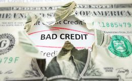 Bad credit. Text under a torn dollar bill Stock Photography