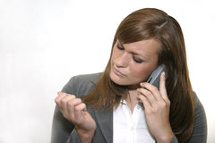 Bad Customer Service. Young businesswoman on phone examining her nails Stock Photos