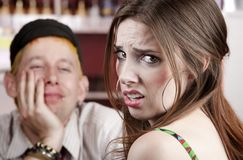 Bad Date. Young woman making an exasperated expression gesture on a bad date Royalty Free Stock Photography
