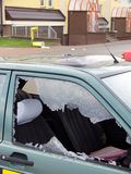 Bad day. For owner car - vandal or thief or accident - destroyed window-pane, probably vandal destroyed window-pane and wastepaper basket stock photography