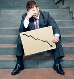 Bad day!. Desperate businessman showing negative graph Stock Photography
