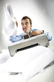 Bad day. Portrait of annoyed businessman holding papers printed by scanner Royalty Free Stock Image