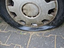 Bad day. For owner car - punctured tyre car royalty free stock photography