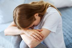Poor young woman crying at home royalty free stock images