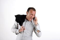 Bad day in office. Angry businessman yelling at phone Stock Photos