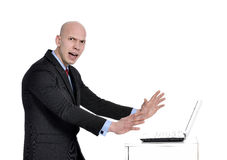Bad day at work. Photo of an caucasian male frustrated with work sitting in front of a laptop Stock Image