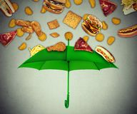 Bad diet protection concept greasy fatty fast food falling down Royalty Free Stock Photography