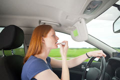 A bad driver - woman putting on makeup Royalty Free Stock Photo